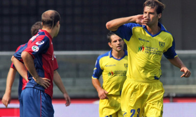Chievo's Erjon Bogdani of Albania, right, celebrates after scoring during a Serie A soccer match against Genoa at the Bentegodi stadium in Verona, Italy, Sunday, Sept. 20, 2009. (AP Photo/Felice Calabro')