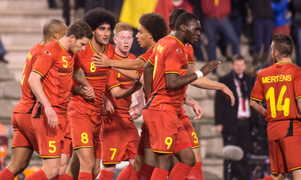 Belgium's Marouane Fellaini, third left, celebrates with teammates after he scored during a friendly soccer match against Ivory Coast at the King Baudouin stadium in Brussels on Wednesday March 5, 2014. (AP Photo/Geert Vanden Wijngaert)